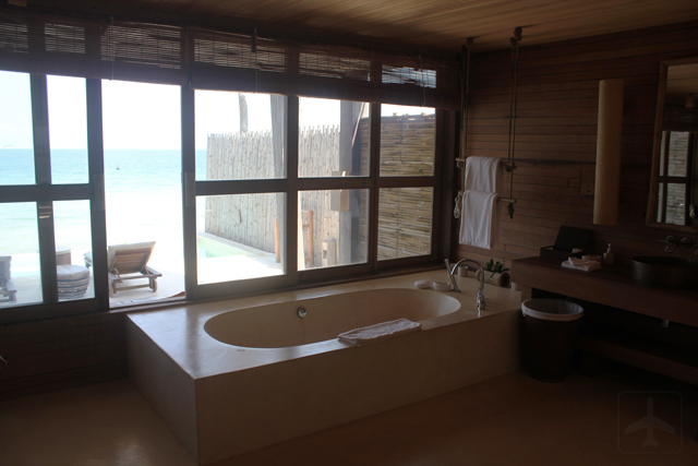 The spacious bath area with a sea view!