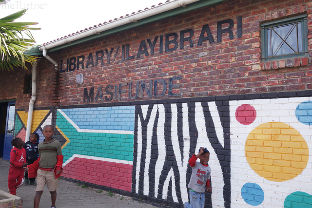 Children playing outside the library in the township